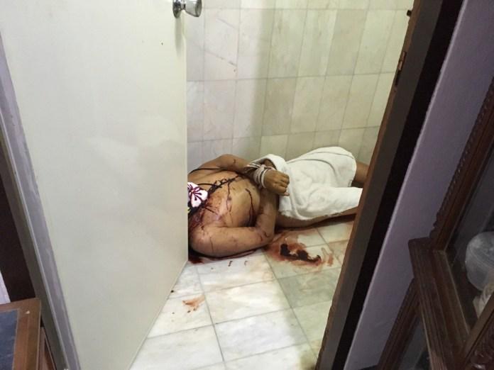 Laying naked on the bathroom floor