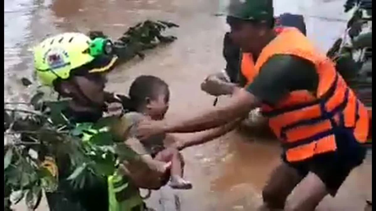 Laos Flood Strands Four-Month-Old Child For Days
