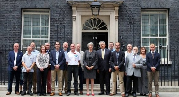 UK premier welcomes hero British divers to Downing Street