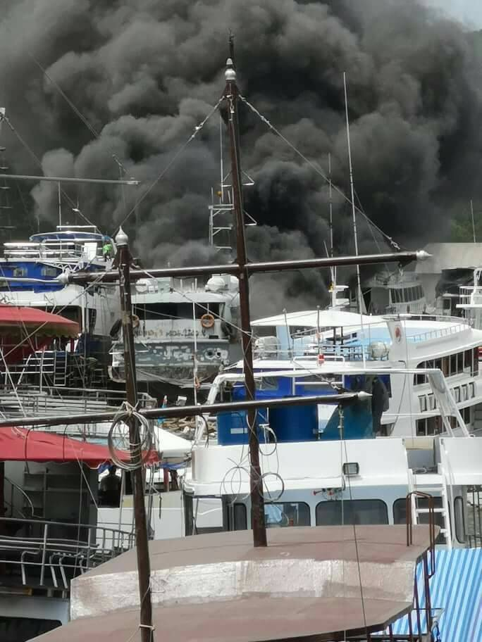 Boat at catches fire at Phuket pier