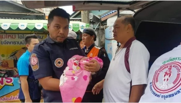 Abandoned baby found in grocery box. A newborn baby boy was found abandoned at a grocery store on Soi Rama 9 in Bangkok's Huai Kwang district on