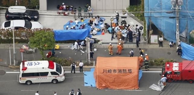 Police say man kills two in Japan stabbing that injures 16 schoolgirls