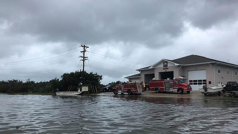 Hundreds stranded on North Carolina island, 'catastrophic' flooding as Dorian moves off coast