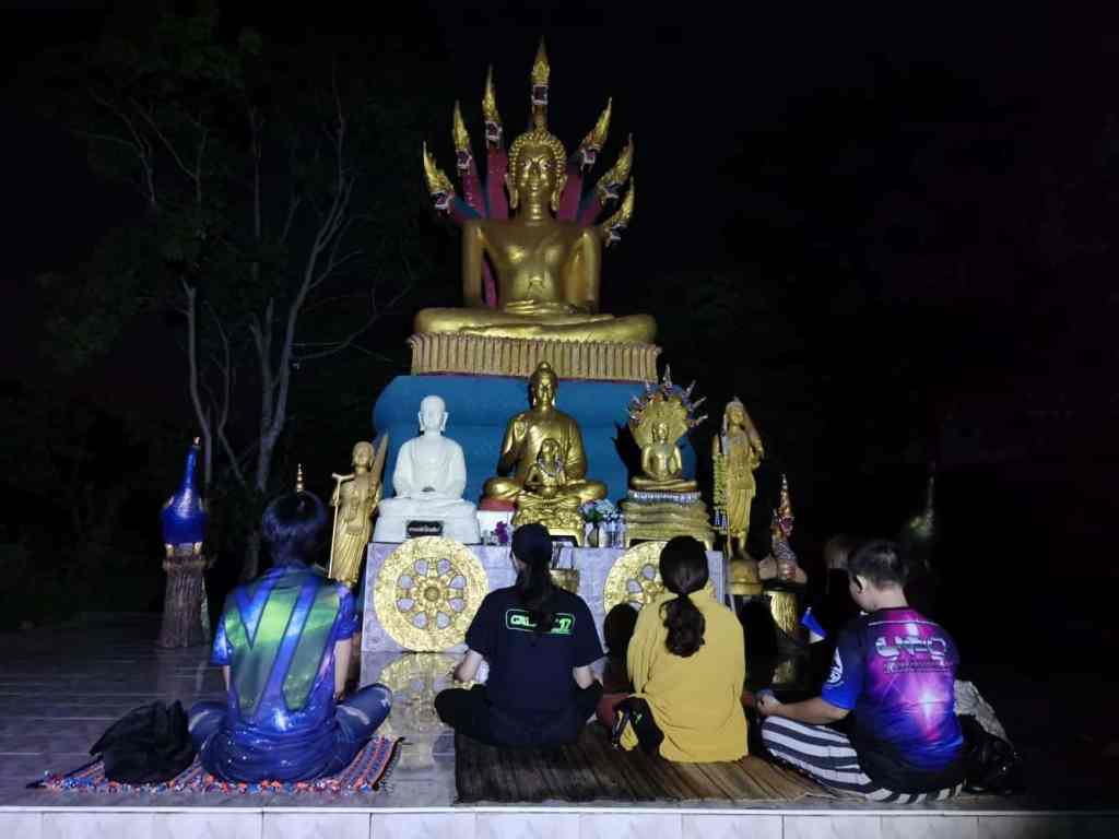Thai people meditate for aliens