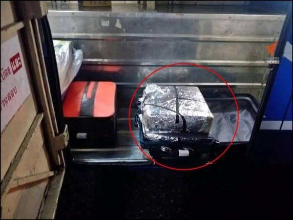 Serving police officer arrested with 198,000 meth pills in his luggage on a bus in Chiang Rai province