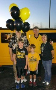 Patterson Legal Group and Jerseys Grill and Bar donate Shocker basketball package to Make a Wish child Kody