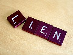 Liens are difficult to handle in Kansas, don't get scrabbled.