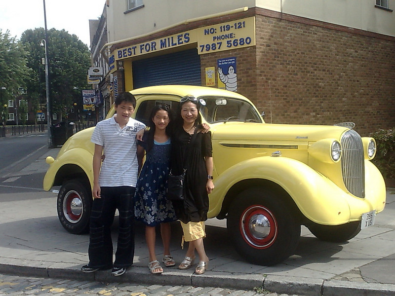 Mai and children and a Plymouth HotRod