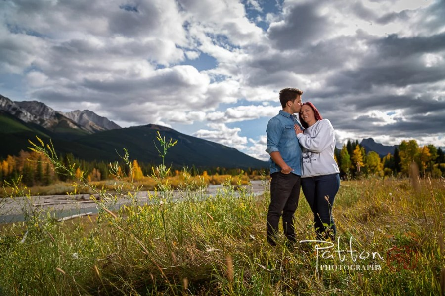 Engaged couple near a river in Kananaskis