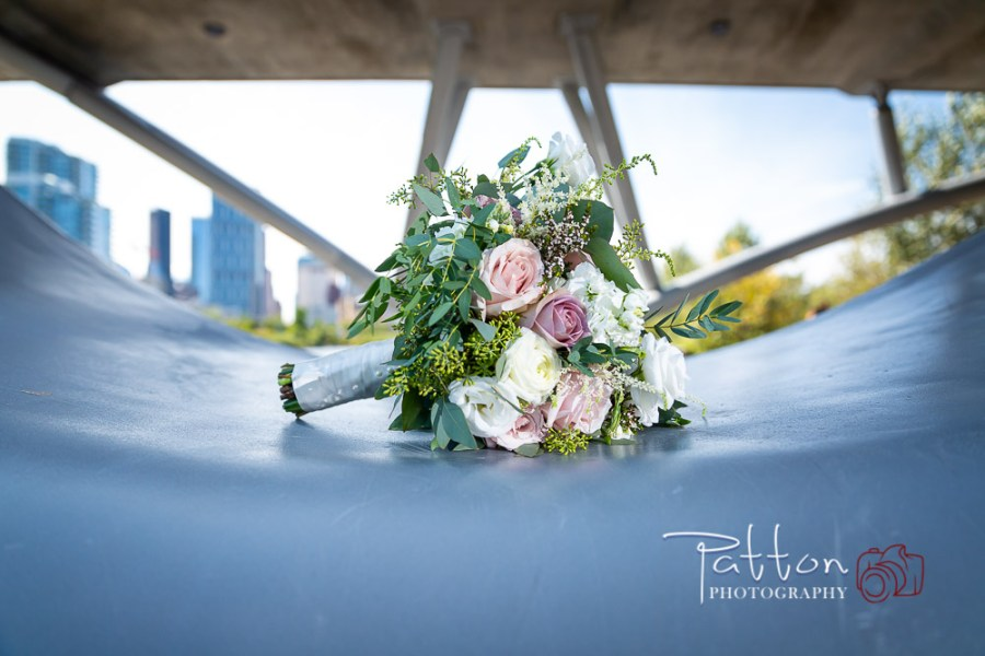 Calgary wedding bouquet on bridge - Beautiful Fish Creek wedding