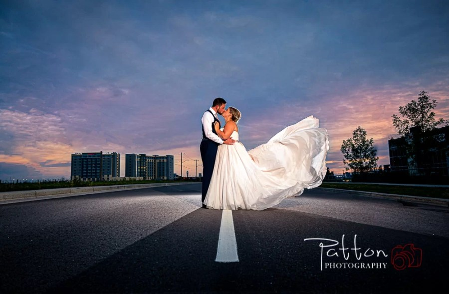Bride and groom on Calgary road at dusk
