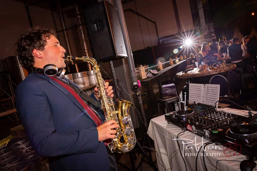 Saxophone player at a Calgary Railyard Brewery wedding2