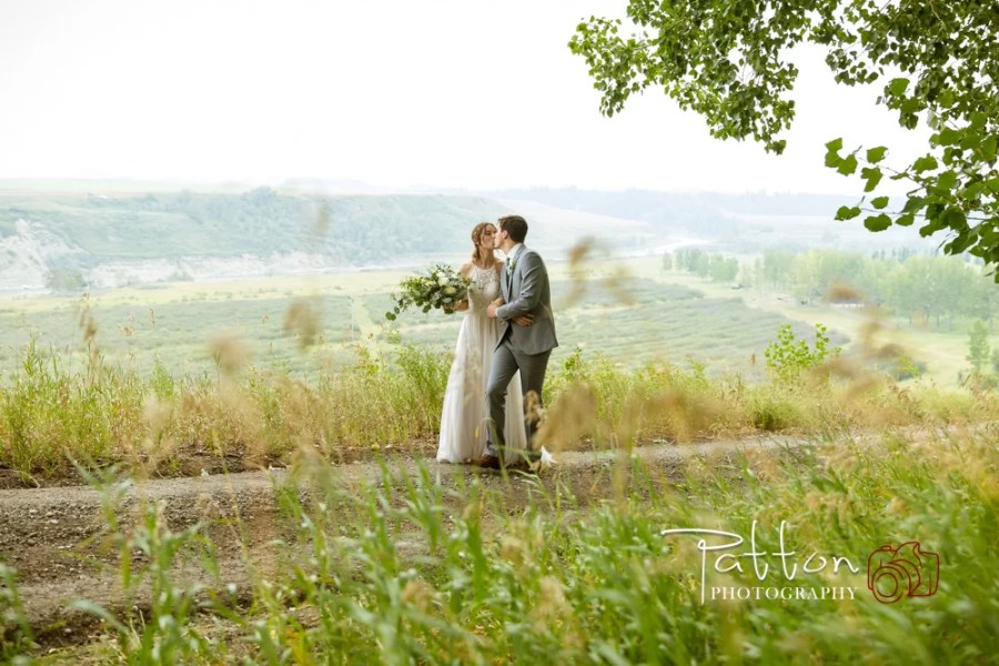 Calgary bride and groom kissing at Saskatoon Farm wedding