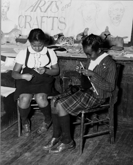 """Girls engaged in knitting and making toy animals in the handicraft class of the St. Simon's Youth Center of the National Youth Administration, Philadelphia, Pennsylvania, 1941. Library of Congress Prints and Photographs Division."""