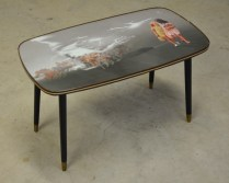 Haunt II, 45x80x35cm, digital collage, glass, coffee table legs (2013)