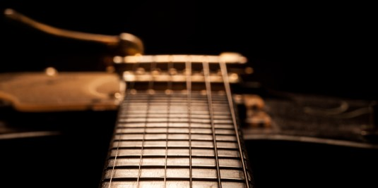 Looking down the neck of a guitar.