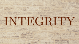 The word Integrity on a sandstone background