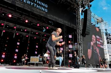 Joel Houston of Hillsong United live at the Together 2016 gathering on the National Mall in Washington, D.C.
