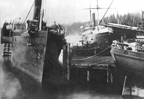 Sidewheel steamer Pacific, on the left, at the end of Yesler's Wharf in 1875 before setting off for its tragic end