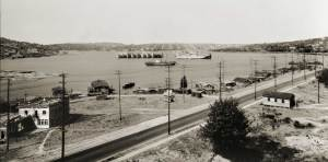 Then: Photographed from an upper story of the Ford Factory at Fairview Avenue and Valley Street, the evidence of Seattle's explosive boom years can be seen on every shore of Lake Union, ca. 1920. Courtesy of MOHAI
