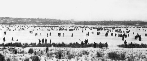 Then: The thousands of skaters on Green Lake in this late January 1916 view could not have known that the skating would soon be over, one of the victims of the Big Snow of 1916. Courtesy Fairlook Antiques