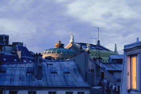 From above Rue du Helder morning light slants across the rear of Opera de Paris.