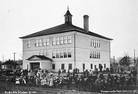 In 1909 the Seattle photographer Edwin Pierson was commissioned to photograph the schools of King County, and in many examples their student bodies posing or playing before them.  Here is Pierson's 1909 capture of Auburn's Primary School.