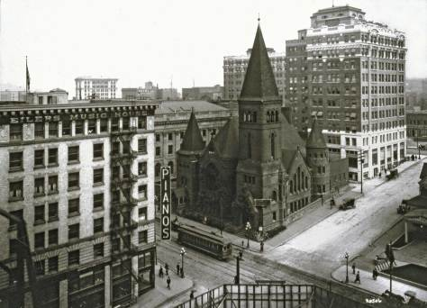 Looking northeast from a rear window in the Savoy Hotel on Second Avenue and over the construction pit for a building that would be home eventually for the Pacific Outfitting Co., to Plymouth Church in its last moments.   Photo by Asahel Curtis. Courtesy Lawton Gowey