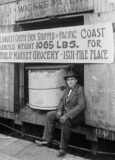 """Some really big cheese headed for the Pike Place Market - but I don't know when, only that it was really really big.  I also do not know if this photo was taken first, or the one that follows of our really big cheese on a wagon was first.  I'm inclinded to thing this big cheese is here waiting for the wagon, but I am prepared to be corrected by someone who knows better how to """"read"""" this photograph."""