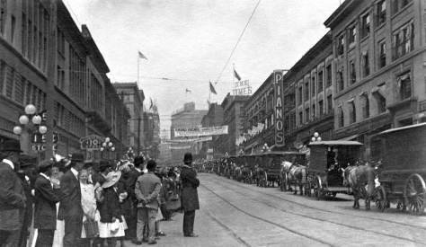 Philip Hughett has shared the date for this look north on Second from University Street.  This is July 4, 1910.  A few of the buildings survive but so many of the fashions.  In 1910 it was still likely that a parade would includes long lines of horse-drawn wagons carrying not VIPS - they would have by then taken to motorcars - but the regulars, those who pay their bank fees, shop for bargains and in a lifetime might get to ride in a parade.