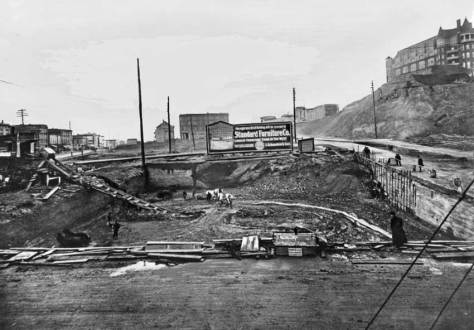 Here's a rough look into the construction pit for Standard Furniture.  Note that the Second Avenue regrade on the right is getting its polish.  The old Washington Hotel (first named the Denny Hotel) atop the front or south summit of Denny Hill still stands, but not for long.  It was destroyed in 1906 and by 1908 the south summit was removed and the New Washington Hotel and Moore Theatre filled the east side of Second between Steward and Virginia Streets.