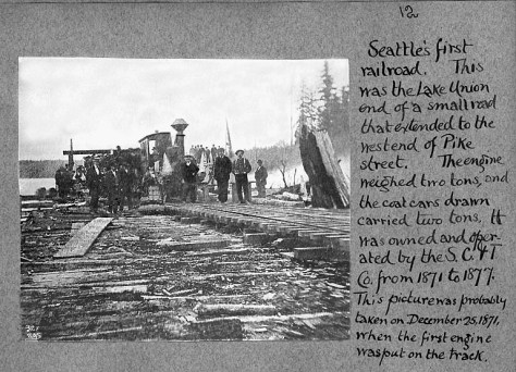 "Probably the oldest photograph of any part of Lake Union, the South years before the Western Mill and on the ""free rides"" for citizens on the railroad that ran from the here to the Pike Street dock and coal bunkers.  The date is late 1871.  By the end of the 70s the coal cars were rerouted on a new line from Newcastle, thru Renton and around the south end of Lake Washington to a new coal wharf at the waterfront foot of King Street (seen many times in these now more than 400 pages)."
