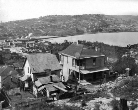 The south end of Lake Union with a Queen Anne Hill horizon.  The view dates from ca. 1902.  Western Mill is, again, evident, and the Westlake Trestle with the temporary cove beyond it to the west.