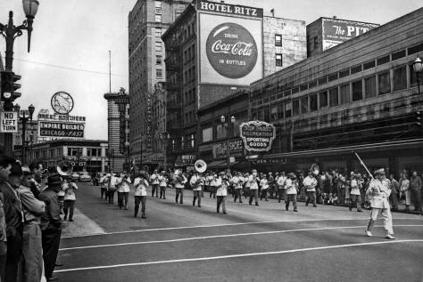 A parade heads south on 4th in the block between Olive Way and Pine Street on May 30, 1953.  The Lutheran corner is - or was - on the far right.  Behind it the Hotel Ritz was home for the Carpenters Union.  Beyond that the Mayflower Hotel and the Times Square Building sit respectively on the south and north sides of Olive Way, and still do. Note the once popular Great Northern goat sign down the way.   Mid-block is the once popular Ben Paris.