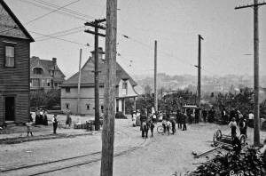 THEN: The rear end of the derailed trolley on N. 35th Street appears right-of-center a few feet east of Albion Place N. and the curved track from which the unrestrained car jumped on the morning of August 21, 1903. (Courtesy, Fremont Historical Society)