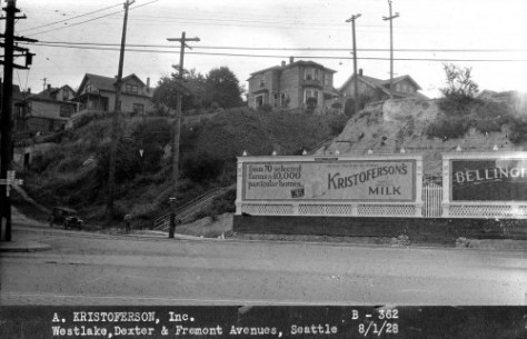The Foster & Kleiser billboard at the meeting of Westlake, Dexter and Fremont Avenues in August 1928, showing here art for Kristoferson's Milk.