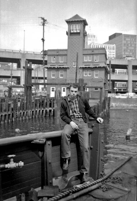 Mike Cirelli posing at the stern/bow of the Vashon on the Seattle waterfront.