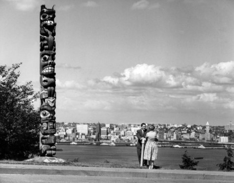 The Admiral Way Totem ca. 1960.  Since 1939 the popular West Seattle prospect of Elliott Bay at Belvedere Viewpoint has been marked by its own Totem Pole—or two of them. The current and slightly broader pole replaced the rotting original in 1966. Now it, too, is scheduled for replacement.