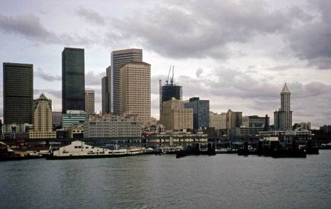 Photographed from a ferry - perhaps by me or Lawton - on Feb. 28, 1984.  The Columbia Tower is underway - and not yet gone away.  The name, that is.  The Smith Tower, far right, is flying Ivar's Salmon Sock.  Ivar has a year to live and soon he will sell the tower, carrying a one million dollar check in his pocket - first payment - to show off.  It was almost as thrilling as opening his monthly social security check.
