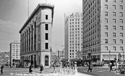 "Long-time ""real photo postcard"" artist Ellis looks east a the Times Square Building's split between Stewart on the left and Olive on the right.  Far right is the Mayflower Hotel.  One many estimate the age of the undate photo with clues from its cars."