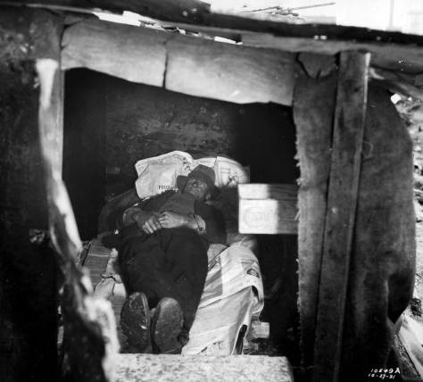 A  resident in on the earlier home built on the Hooverville site.  This one dates from October 27, 1931.  The day's newspapers were a clean cover for a home with no easy way to wash-up.