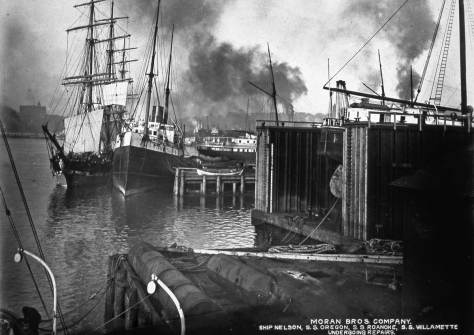 Looking north along the outer water edge of the Moran shipyard, ca. 1903.  The Denny aka Washington Hotel on the summit of Denny Hill holds the horizon, far right. Again, courtesy of Hal Will.