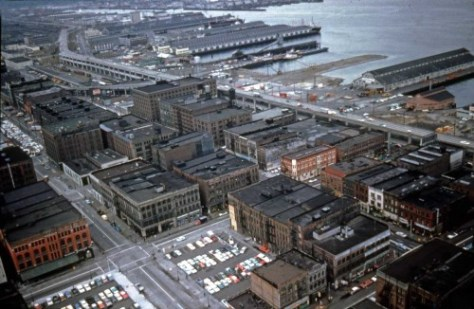 The south central waterfront viewed south from the Smith Tower on July 5, 1962.  The preps for the Port's container field are underway near the foot of Dearborn Street.  The photo was captures by Robert Schneider and is used compliments of him.
