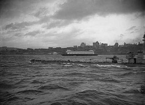 "The caption from an unidentified source reads, ""Sub Carp and ferry in Elliott Bay 1945."""
