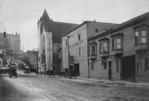 THEN: Sometime between early December 1906 and mid-February 1907 an unnamed photographer with her or his back about two lots north of Pike Street recorded landmarks on the east side of Third Avenue including, in part, the Washington Bar stables, on the right; the Union Stables at the center, a church converted for theatre at Pine Street, and north of Pine up a snow-dusted Denny Hill, the Washington Hotel. (Used courtesy of Ron Edge)