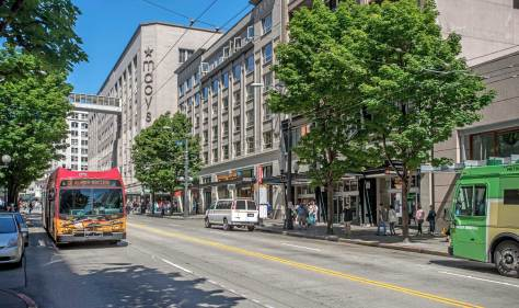 NOW: Within six years following the completion of regrading on Third Ave as far north as Pine Street and Denny Hill in the spring of 1905, the hill was removed and the avenue graded and paved as far north as Denny Way.