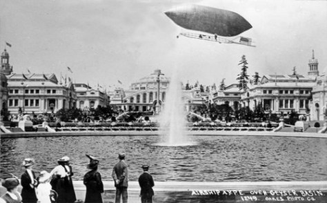 "Retouched to fly above the AYP's fountain (now Frosh Pond) the attentive fair visitors, bottom-left, have also been plopped in place by Otto Oakes, the prolific ""real photo"" postcard producer in those years.  It is a small shame that Oakes did not have the conveniences of photoshop."