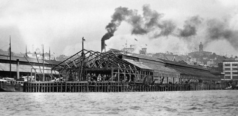 "Extending the Northern Pacific's ""Alaska Piers Nos. 1 and 2"" early in the 20th century. They covered the site of the original Yesler Wharf at the waterfront foot of Yesler Way."