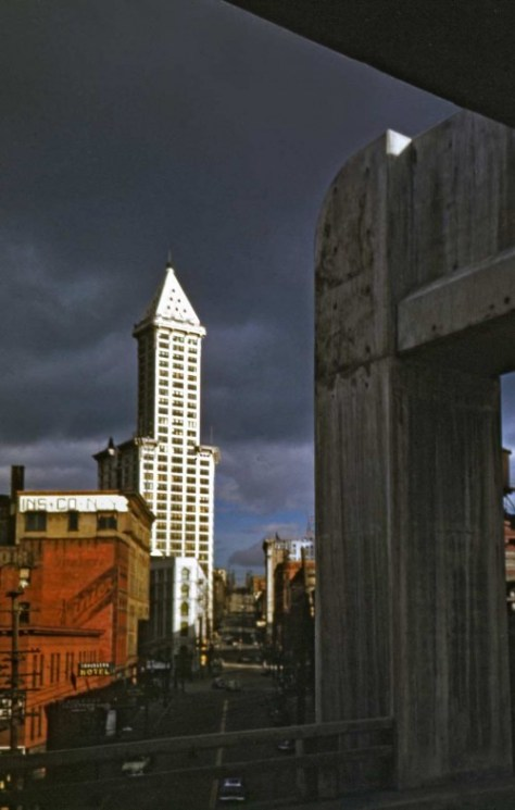 Yesler way and the Smith Tower with its tiles gleaming as advertised - or remembered.  The photo was taken by either Robert Bradley or Horace Sykes.  Their collections came to me mixed.  The date is from some day before April Fools Day 1953, with the subject being one of several taken during a walk of the new Yesler Viaduct, before it was opened to traffic.