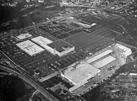 An early aerial of the University Village, looking northwest with 45th Street, bottom-left.  Some of the Nursery culture survives above the Frederick and Nelson box and beside the bowling alley, top-center.  (And what a loss!)